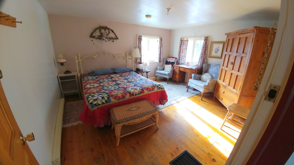 Massive room has 1 queen bed and a bath with jetted tub.
